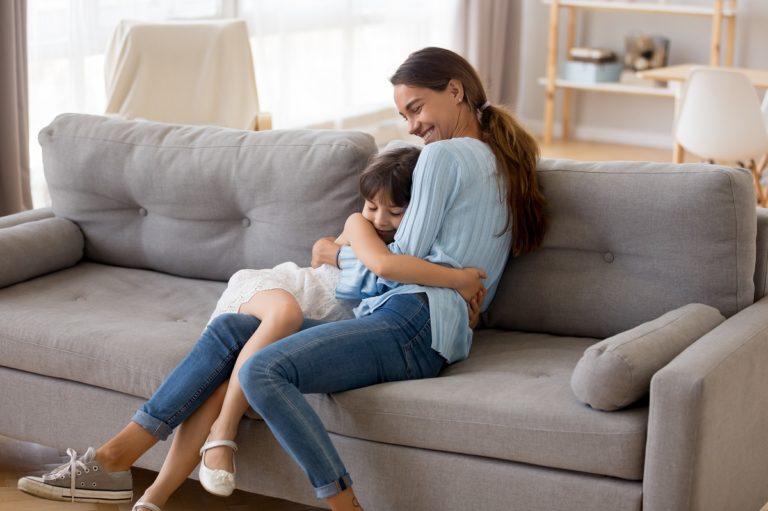 sitter hugging a kid